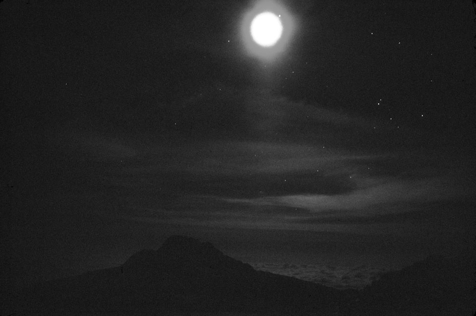 The moon over Mawenzi mountain, taken from the slopes of Mount Kilimanjaro.