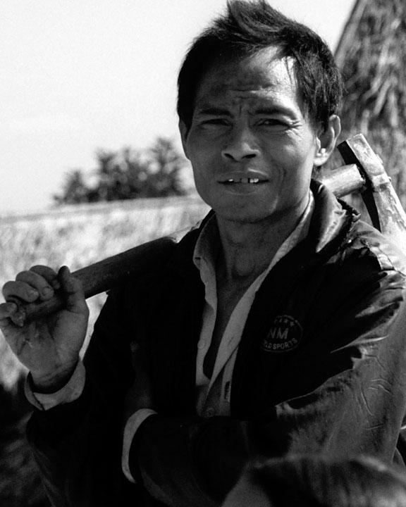 Axeman, Laos, by Cecilia McAnulty / Hadden